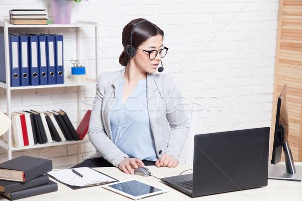 Office callcenter girl works at the computer Stock photo © dmitriisimakov