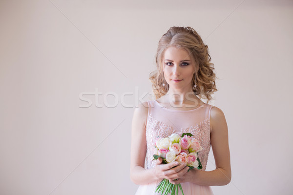 bride in wedding dress holding a bouquet of flowers Stock photo © dmitriisimakov