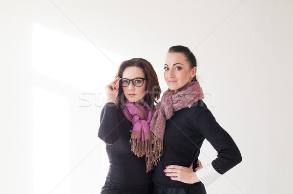 two girls cuddling a laughing glasses Stock photo © dmitriisimakov