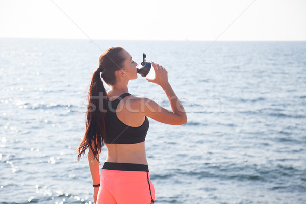 Stock photo: girl after sport classes drinks water