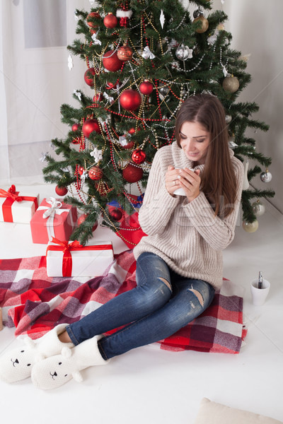girl drinking coffee under the Christmas tree new year tea Stock photo © dmitriisimakov