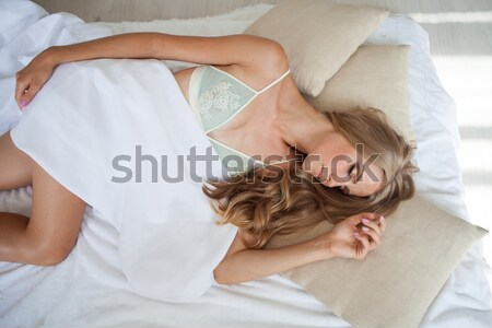 Menina adormecido lingerie cama branco mulher Foto stock © dmitriisimakov