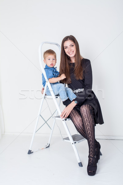 mother and young son on the stairs stepladder Stock photo © dmitriisimakov