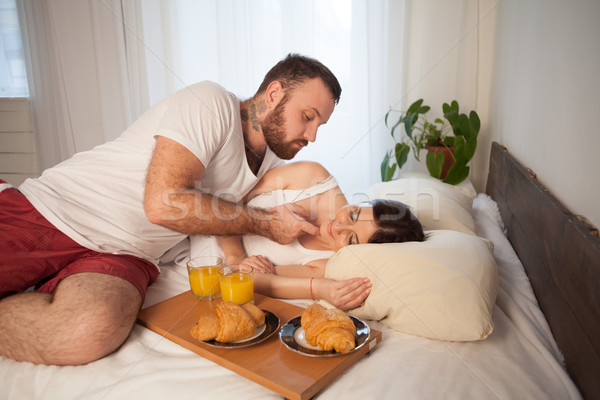 guy with girl, wake up in the morning in the bedroom Stock photo © dmitriisimakov