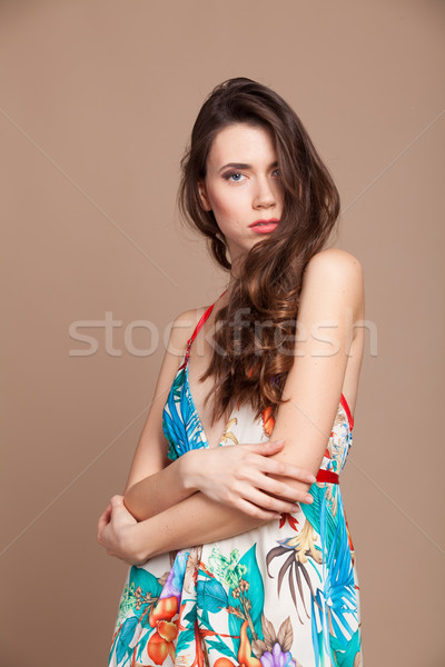 Beautiful girl in colored dress posing smile Stock photo © dmitriisimakov
