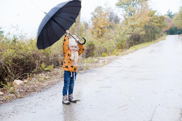 a little boy walks in the rain umbrella autumn Stock photo © dmitriisimakov