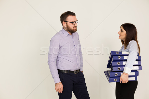 a man and a woman met at the Office many working papers Stock photo © dmitriisimakov