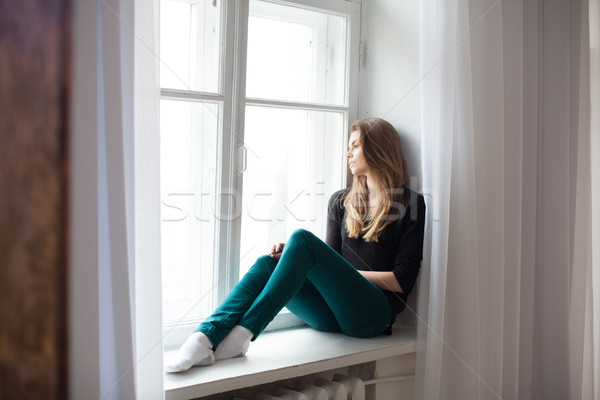 the girl sitting by the window watching the street Stock photo © dmitriisimakov