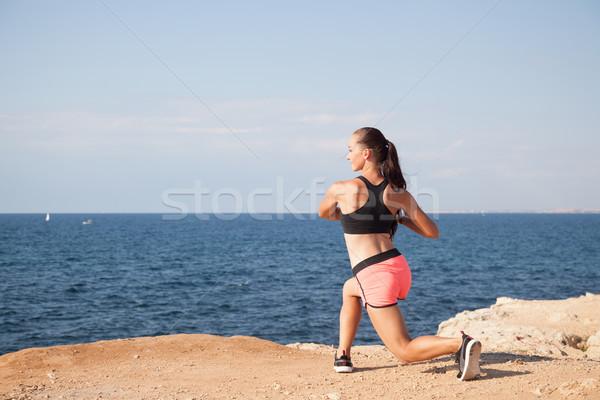 девушки спортивных фитнес пляж морем воды Сток-фото © dmitriisimakov