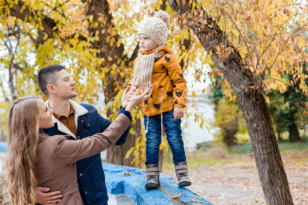 a family with a young boy in the autumn forest walk Stock photo © dmitriisimakov