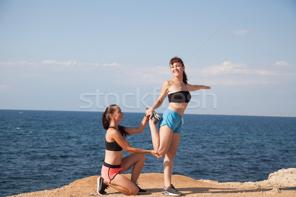 Stock photo: fitness instructor teaches a woman to play sports