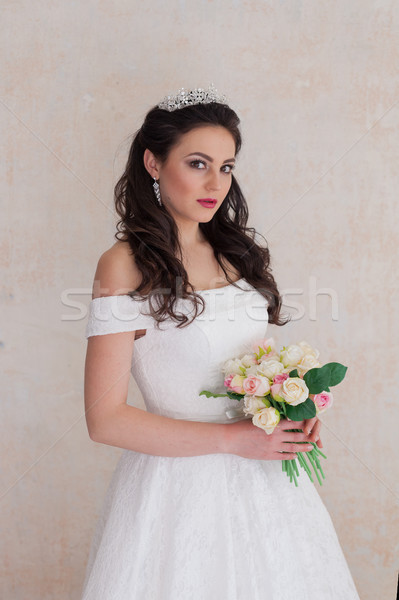 bride Princess stands in a wedding dress with flowers Stock photo © dmitriisimakov