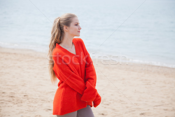 a woman walks by the Sea Beach one in autumn Stock photo © dmitriisimakov