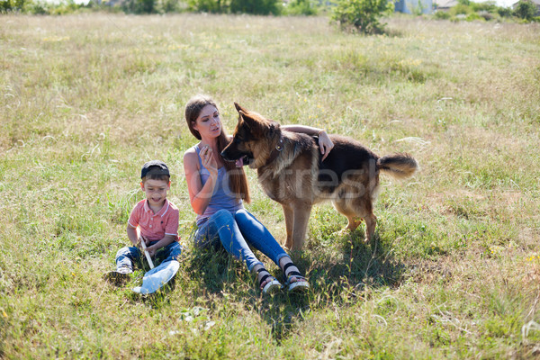mom and son playing with dog sheepdog training Stock photo © dmitriisimakov