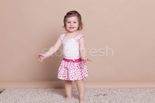 little girl in a pink dress laughter smile Stock photo © dmitriisimakov
