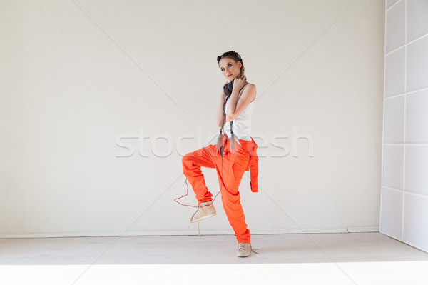 girl with braids listens to music and dances Stock photo © dmitriisimakov