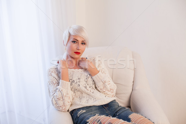 Portrait of a woman blonde at home Stock photo © dmitriisimakov