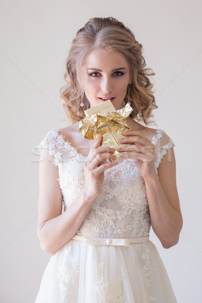 the bride at a wedding in room eating white chocolate Stock photo © dmitriisimakov