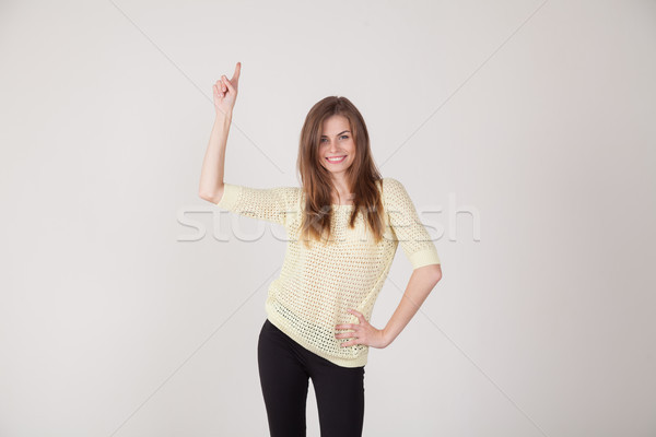 beautiful girl shows hand up Stock photo © dmitriisimakov