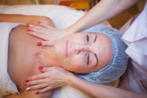 Cosmetology Spa woman doing facial massage Stock photo © dmitriisimakov