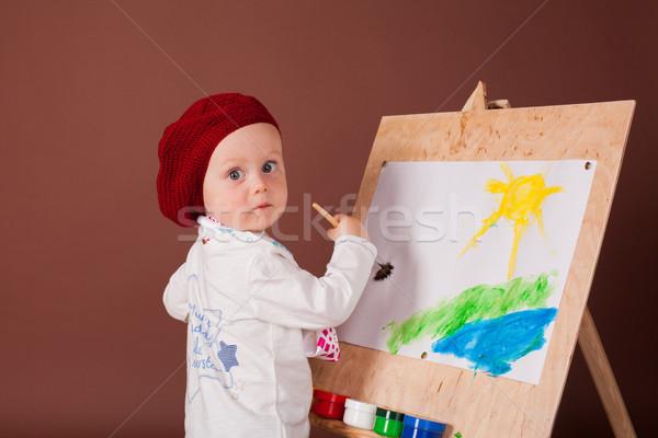 Pequeno menino artista escove quadro cara Foto stock © dmitriisimakov