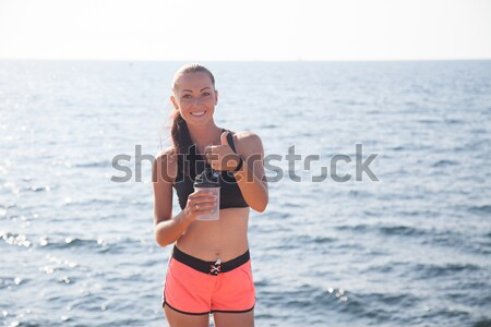 girl in bathing suit sunning on the beach by the sea Stock photo © dmitriisimakov