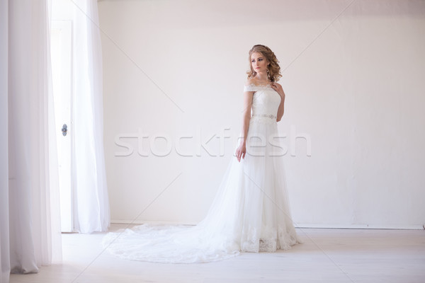bride in wedding dress in a white room Stock photo © dmitriisimakov