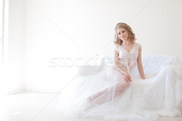 Bella ragazza lingerie seduta bianco divano wedding Foto d'archivio © dmitriisimakov