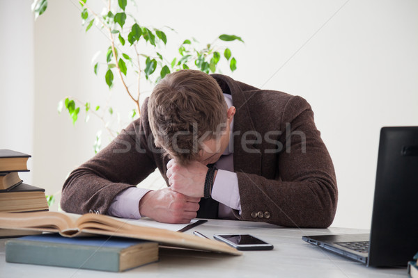 a man in a business suit fell asleep at a desk Stock photo © dmitriisimakov