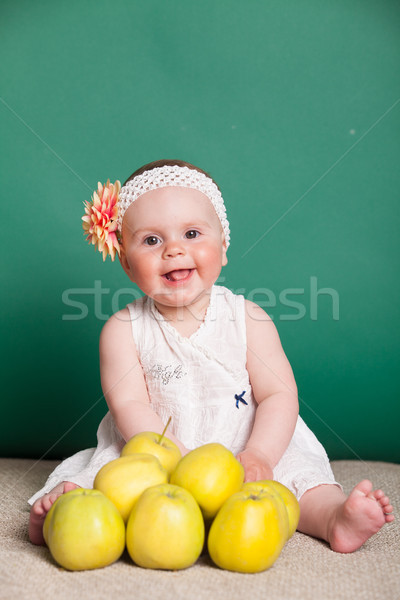 Stock photo: baby girl in a dress with Green apples