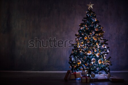 Christmas tree with lights and garlands and gifts home for Christmas Stock photo © dmitriisimakov