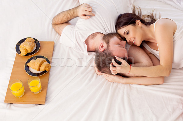 a man with a woman in the morning woke up to breakfast in bed Stock photo © dmitriisimakov
