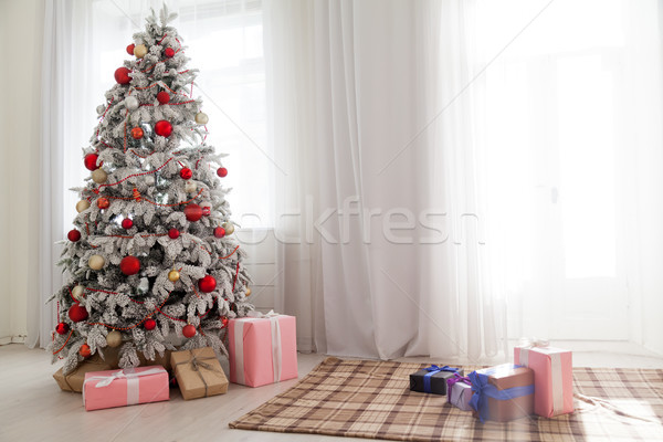 Christmas decoration Christmas tree with presents in white Stock photo © dmitriisimakov