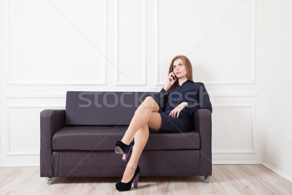 Working girl sits on the couch Stock photo © dmitriisimakov