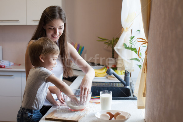 mother and son prepare pie with flour Stock photo © dmitriisimakov