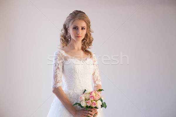 bride in wedding dress with a bouquet of flowers Stock photo © dmitriisimakov