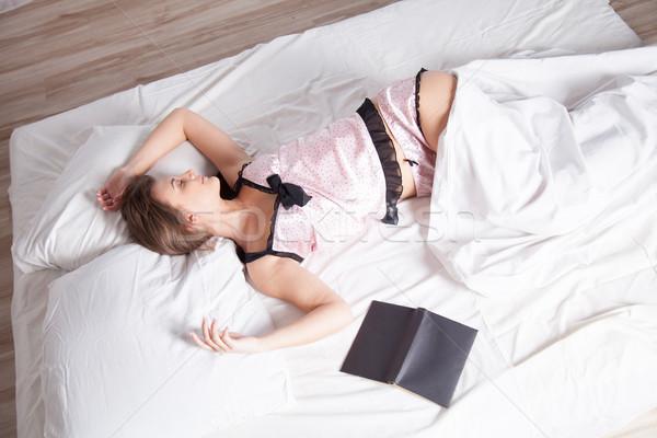 Lány pizsama ágy könyv fal gyermek Stock fotó © dmitriisimakov