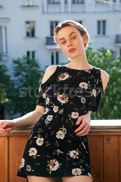 blonde woman in a dress with flowers on the street Stock photo © dmitriisimakov