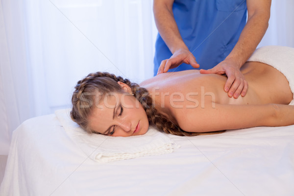 a woman doing a back massage in the Spa 1 Stock photo © dmitriisimakov