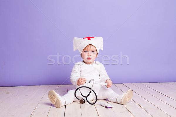 little girl plays in the hospital nurse Stock photo © dmitriisimakov