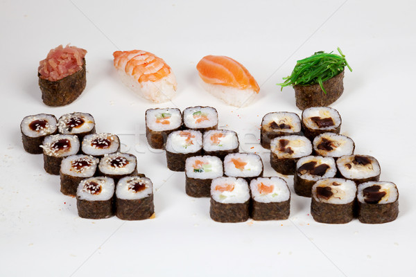 Sushi rolls Japanese food restaurant fish figure on a white background Stock photo © dmitriisimakov