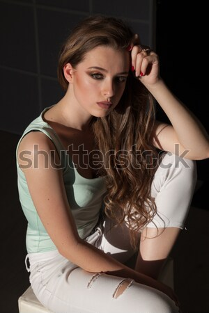 beautiful woman with make-up and hairdo sitting in the bright clothes Stock photo © dmitriisimakov