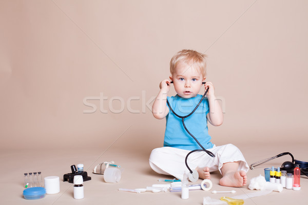 Boy playing in the doctor in the hospital Stock photo © dmitriisimakov