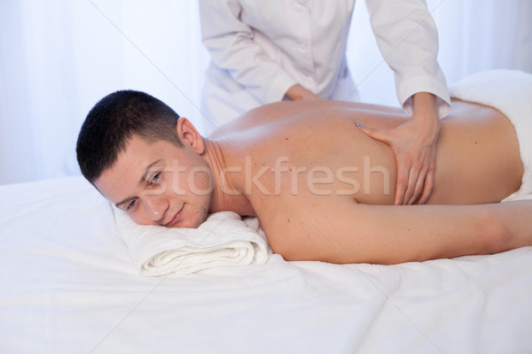 a massage therapist makes therapeutic massage man Spa Stock photo © dmitriisimakov