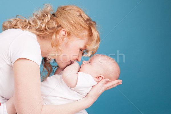 Stock photo: mom keeps on hand a baby son love happiness