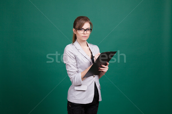 business woman secretary stands with folder Stock photo © dmitriisimakov