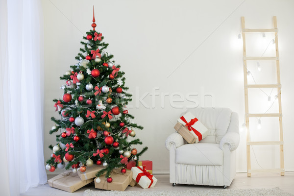 Christmas tree in a white room with a Christmas greeting gifts Stock photo © dmitriisimakov