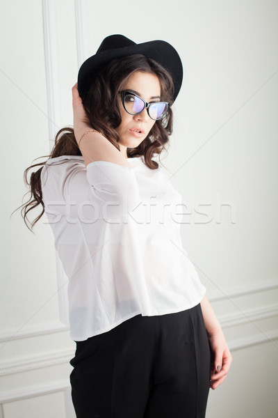 beautiful girl with Hat and glasses in the Studio curls hairstyle Stock photo © dmitriisimakov