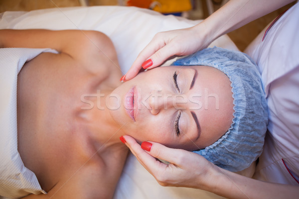 Cosmetology Spa woman doing facial massage Stock photo © dmitriisimakov
