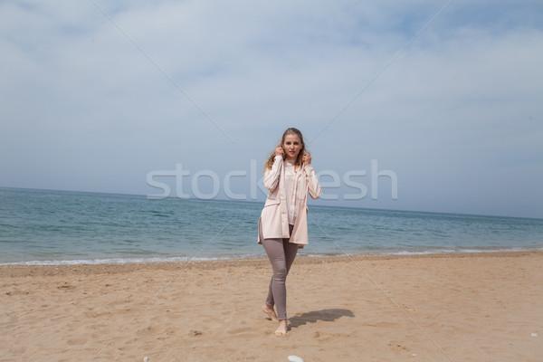 Szőke nő lány sétál homokos tengerpart tenger part Stock fotó © dmitriisimakov